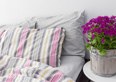 Bedroom decorated with bright purple flowers Stock Photography