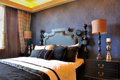 Bedroom deep blue decoration in noble style. Bedroom in featured deep blue decoration, in noble style and fine furniture, shown as luxury, classical, and Royalty Free Stock Photos