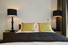 Bedroom detail. Detail of a king size bed with luxury elements Stock Photography