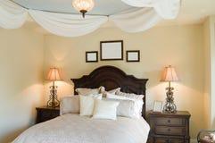 Bedroom Detail. Luxurious Bed in Modern Bedroom stock photos