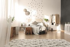 Bedroom with dot wall. White bedroom with dot wall and pallet bed stock photo