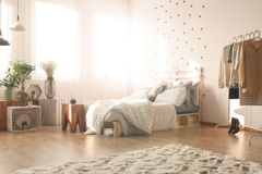 Bedroom with dots. Cozy bedroom with dots on the wall and bedsheets royalty free stock photo