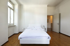 Bedroom with a double bed. Nice apartment refitted, bedroom with a double bed royalty free stock images