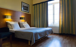 Bedroom with double bed Stock Photos