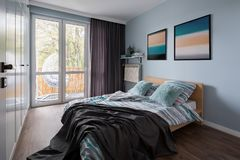 Stylish bedroom with double bed royalty free stock photo