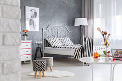 Bedroom with dressing table. Grey and white modern woman`s bedroom with dressing table Stock Images