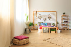 Bedroom with ethnic bed decoration Royalty Free Stock Image