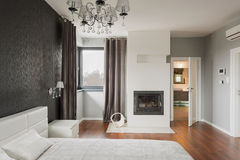 Bedroom with fireplace Royalty Free Stock Photos