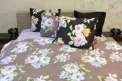 Bedroom with floral bedlinen Stock Image