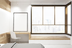 Bedroom with framed poster Royalty Free Stock Images