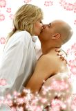 Bedroom games with flowers #2. Sweet couple playing and kissing in bedroom with flowers Stock Image