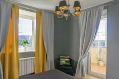 Bedroom in gray and yellow tones royalty free stock photography