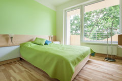 Bedroom with green elements Royalty Free Stock Photo
