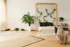 Bedroom with hammock. Stylish natural bedroom with simple hammock and plants royalty free stock photography