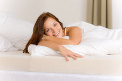 Bedroom - happy woman in white bed Stock Image