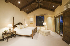 Bedroom With High Wooden Ceiling Royalty Free Stock Photography