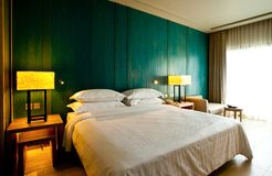 Bedroom Hotel. Modern contemporary bedroom interior ; partition tropical style Stock Images