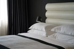 Bedroom of a hotel room. Bedroom design in black in a hotel room Royalty Free Stock Photos