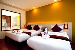 Bedroom Hotel Series 03. Interior of a hotel bedroom in warm colors Stock Photos