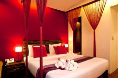 Bedroom Hotel series 05. Interior of a hotel bedroom in warm colors Stock Photo