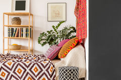 Bedroom in indian style. Warm and cozy bedroom in indian style Royalty Free Stock Image