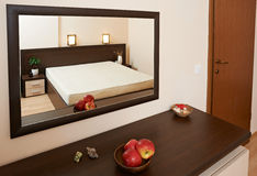 Bedroom inerior example with mirror Royalty Free Stock Photo