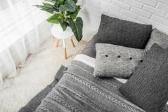 Bedroom interior bed in gray tones with flower on bedside table. And dekor Stock Photography