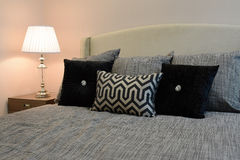 Bedroom interior with black patterned pillows Royalty Free Stock Photo