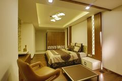 Bedroom interior, Calicut, India. Interior of modern bedroom designed by Amar Architecture and Designs PVT, Ltd in Calicut, India Royalty Free Stock Photos