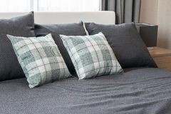 Bedroom interior with checked green pillows Stock Image