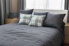 Bedroom interior with checked green pillows Royalty Free Stock Photo