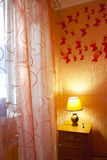 Bedroom interior with curtains, the lamp Stock Images