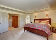 Bedroom interior with deep brown furniture and carpet floor Stock Photography