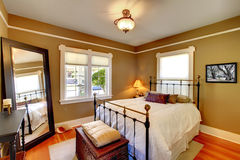 Bedroom interior with golden walls. Stock Photography