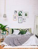 Bedroom interior house style pattern white green. Bedroom interior in gray green tones with pictures on a white wall stock images