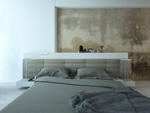 Bedroom interior with king-size bed and old concrete wall Royalty Free Stock Photo