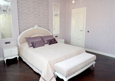 Bedroom interior in light tones.  Stock Photos
