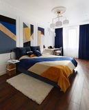 Bedroom interior in modern style with a large bed and paintings Royalty Free Stock Photos