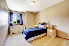 Bedroom interior with navy bedding and curtains Stock Photography
