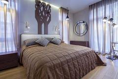 Bedroom. Interior of new designer bedroom in classic style Stock Photography