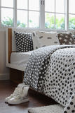 Bedroom interior with polka dot pattern and girl shoes. Bedroom interior design with polka dot pattern and girl shoes on wooden floor royalty free stock photography