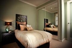 Bedroom interior reflected in mirrors Stock Image
