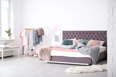 Bedroom interior with soft bed. Bedroom interior with comfortable soft bed royalty free stock images