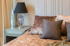Bedroom interior with tweed brown pillows on bed and deco Stock Image