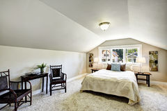 Bedroom interior with vaulted ceiling and sitting area Royalty Free Stock Photography