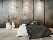 Bedroom interior w. bed in front of concrete wall Stock Image
