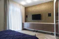 Bedroom interior with wall mounted tv and speakers Royalty Free Stock Photos