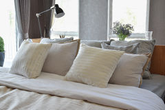 Bedroom interior with white striped pillows on bed Royalty Free Stock Images