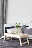 Bedroom Interior With Small Table On Bed Stock Images