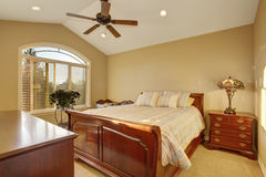 Bedroom interior withh antique wooden furniture and beige walls Stock Photo